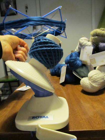 The swift feeds the yarn from the skein to the ball winder.