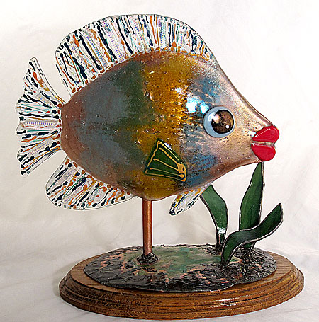 Susan makes fused glass fish. Love the big lips!