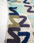 2) Slst legs of the Zs to the blanket. Slst in unused stitches too.